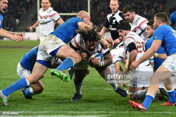France's centre Mathieu Bastareaud dives and scores a try during the Six Nations international rugby union match between France and Italy at the...