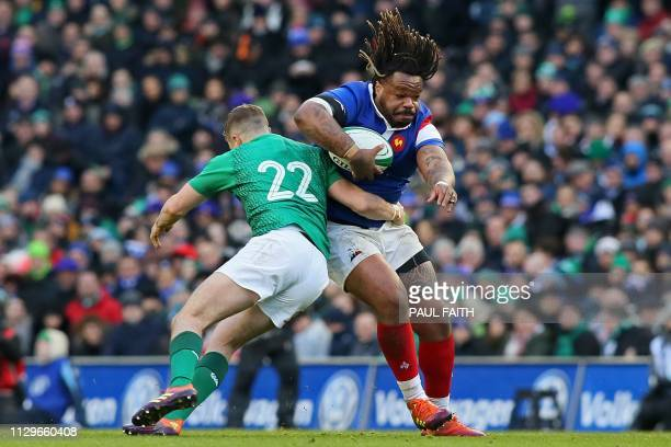 France's centre Mathieu Bastareaud is tackled by Ireland's Jack Carty during the Six Nations international rugby union match between Ireland and...