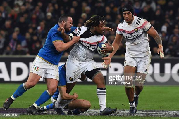 France's centre Mathieu Bastareaud is tackled by Italy's prop Simone Ferrari during the Six Nations international rugby union match between France...