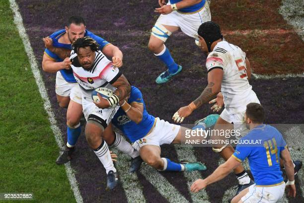 France's centre Mathieu Bastareaud is tackled during the Six Nations international rugby union match between France and Italy at the Velodrome...