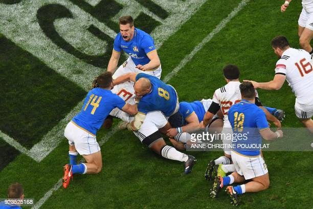 France's centre Mathieu Bastareaud scores a try during the Six Nations international rugby union match between France and Italy at the Velodrome...