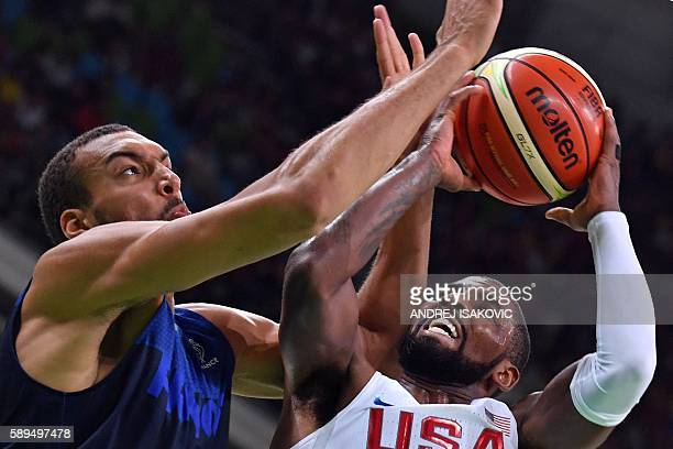 TOPSHOT France's centre Rudy Gobert defends against USA's guard Kyrie Irving during a Men's round Group A basketball match between USA and France at...