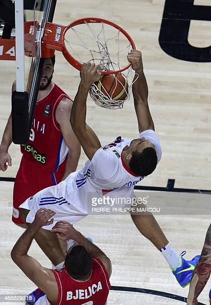 France's centre Rudy Gobert scores during the 2014 FIBA World basketball championships semifinal match France vs Serbia at the Palacio de los...