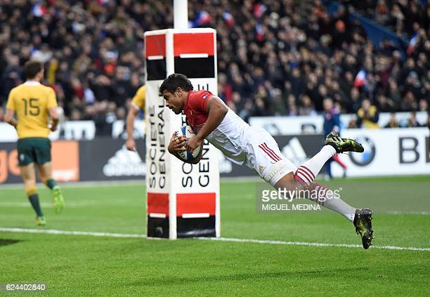 TOPSHOT France's centre Wesley Fofana scores a try during the rugby union test match between France and Australia at the Stade de France in...