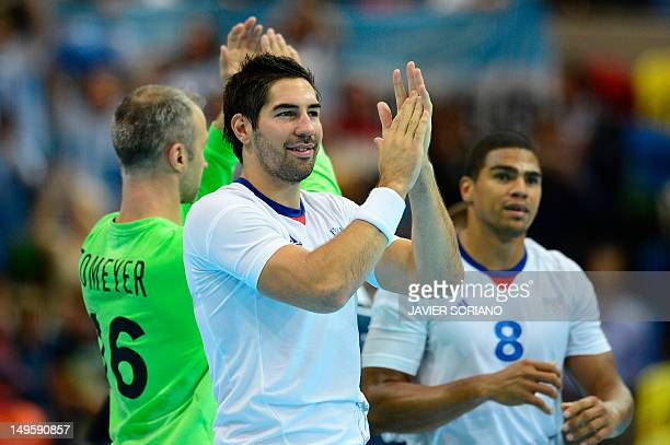 France's centreback Nikola Karabatic applauds as he celebrates their victory over Argentina at the end of the men's preliminaries Group B handball...