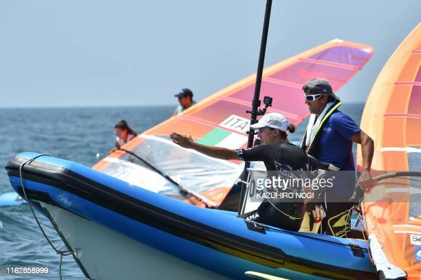 France's Charline Picon chats with her coach during the women's windsurfing RSX class competition at a sailing test event for the Tokyo 2020 Olympic...