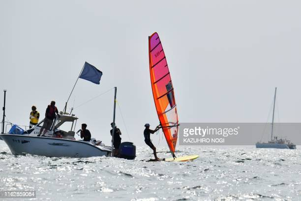 France's Charline Picon crosses the finish in the women's windsurfing RSX class competition during a sailing test event for the Tokyo 2020 Olympic...