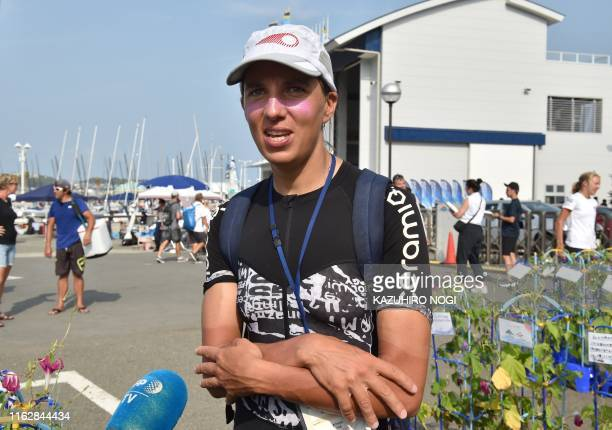 France's Charline Picon speaks to the media after the women's windsurfing RSX class competition during a sailing test event for the Tokyo 2020...