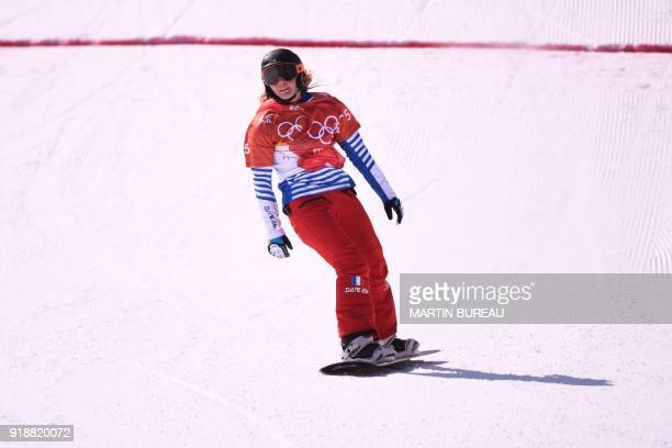 France's Charlotte Bankes wins the women's snowboard cross small final at the Phoenix Park during the Pyeongchang 2018 Winter Olympic Games on...