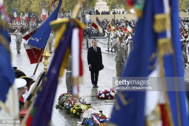 TOPSHOT France's chief of military staff General Francois Lecointre salutes as he stands next to French President Emmanuel Macron at a wreath laying...