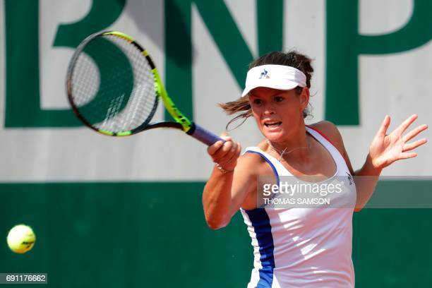 France's Chloe Paquet returns the ball to France's Caroline Garcia during their tennis match at the Roland Garros 2017 French Open on June 1 2017 in...