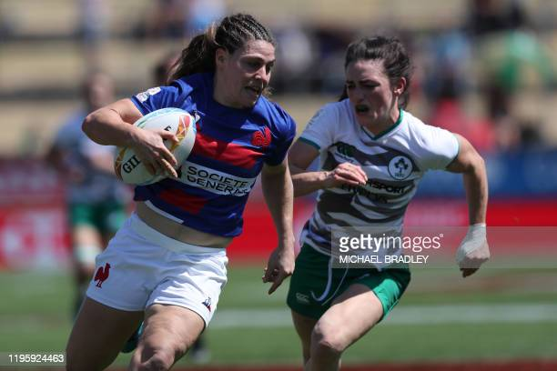 Frances Chloe Pelle makes a break during the women's sevens rugby match between France and Ireland during day one of the HSBC World Rugby Sevens...