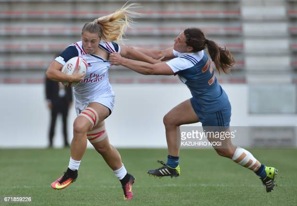 France's Chloe Pelle tackles against Keisi Stockert of the US during their seventh place playoff at the World Rugby Women's Seven Series in...