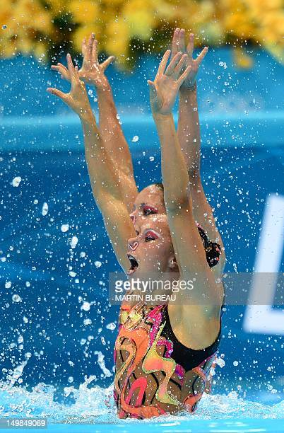 France's Chloe Willhelm and France's Sara Labrousse compete in the duets technical routine during the synchronised swimming competition at the London...