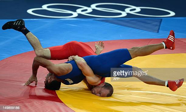 France's Christophe Guenot wrestles Mark Overgaard Madsen of Denmark during their London 2012 Olympic Games 74kg Greco Roman Wrestling Repechage...
