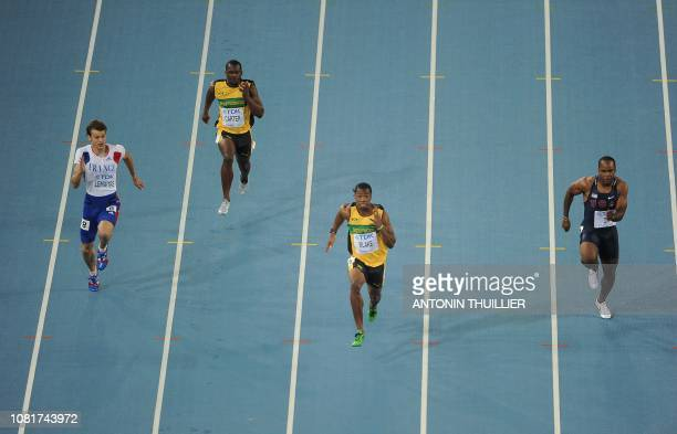 France's Christophe Lemaitre Jamaica's Nesta Carter Jamaica's Yohan Blake and US sprinter Walter Dix compete in the men's 100 metres final at the...