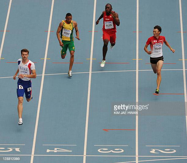 France's Christophe Lemaitre South Africa's Lebogang Moeng Switzerland's Alex Wilson and Japan's Shinji Takahira competes in the men's 200 metres...