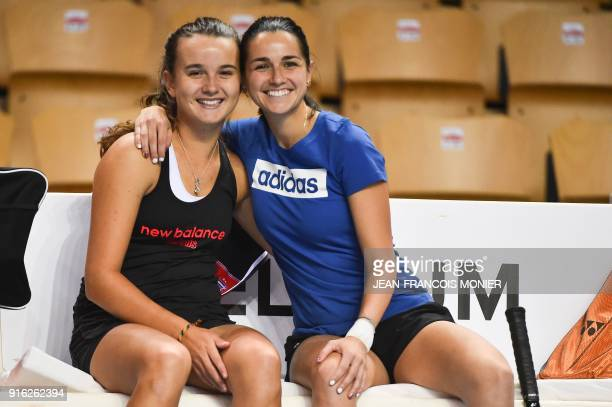 France's Clara Burel and France's Amandine Hesse smile during a training session ahead of the Fed Cup World Group first round tennis match between...