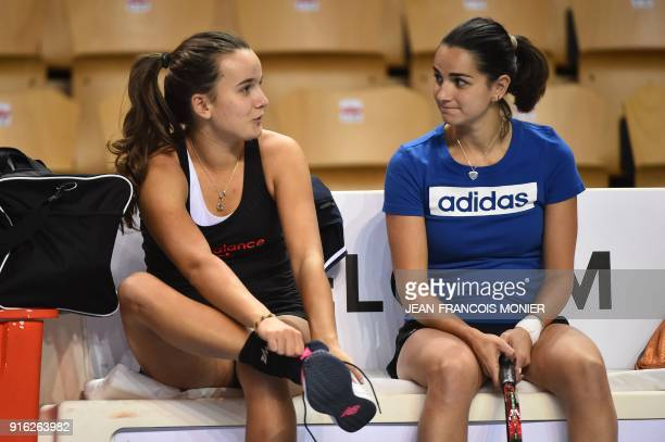 France's Clara Burel and France's Amandine Hesse talk during a training session ahead of the Fed Cup World Group first round tennis match between...
