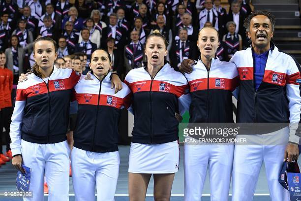 France's Clara Burel France's Amandine Hesse France's Pauline Parmentier France's Kristina Mladenovic and France's captain Yannick Noah sing the...