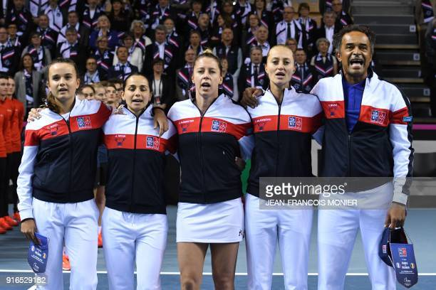 TOPSHOT France's Clara Burel France's Amandine Hesse France's Pauline Parmentier France's Kristina Mladenovic and France's captain Yannick Noah sing...