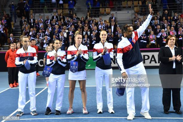 France's Clara Burel France's Amandine Hesse France's Pauline Parmentier France's Kristina Mladenovic and France's captain Yannick Noah acknowledge...