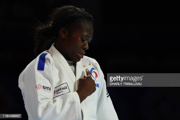 TOPSHOT France's Clarisse Agbegnenou celebrates winning the gold medal after her fight against Japan's Miku Tashiro in the women's under 63kg...