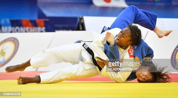 France's Clarisse Agbegnenou fights with Japan's Miku Tashiro in the women under 63kg category of the 2018 Judo World Championships in Baku on...