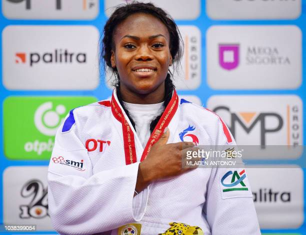 France's Clarisse Agbegnenou listens to the national anthem during the podium ceremony for the women under 63kg category of the 2018 Judo World...