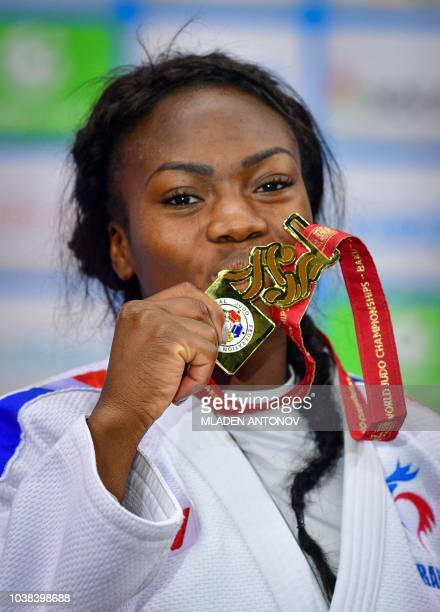 France's Clarisse Agbegnenou poses with her gold medal during the podium ceremony for the women under 63kg category of the 2018 Judo World...