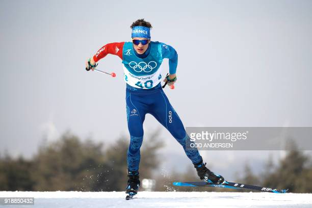 France's Clement Parisse competes during the men's 15km cross country freestyle at the Alpensia cross country ski centre during the Pyeongchang 2018...