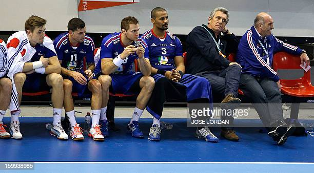 France's coach Claude Onesta and his players react on the bench during the 23rd Men's Handball World Championships quarterfinal match France vs...