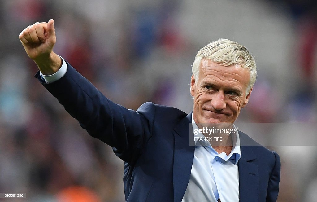 France's coach Didier Deschamps acknowledges the crowds following his team's 3-2 win over England during the international friendly football match between France and England at The Stade de France Stadium in Saint-Denis near Paris on June 13, 2017.