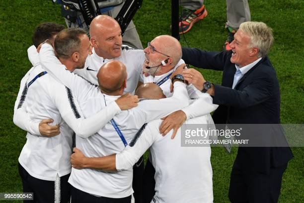 France's coach Didier Deschamps assistant coach Guy Stephan and memebers of staff celebrate at the end of the Russia 2018 World Cup semifinal...