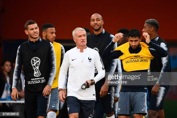 France's coach Didier Deschamps attends with teammates a training session at the Ekaterinburg Arena in Ekaterinburg on June 20 2018 on the eve of the...