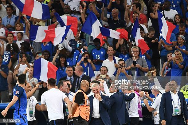 France's coach Didier Deschamps celebrates after winning the Euro 2016 semifinal football match between Germany and France at the Stade Velodrome in...