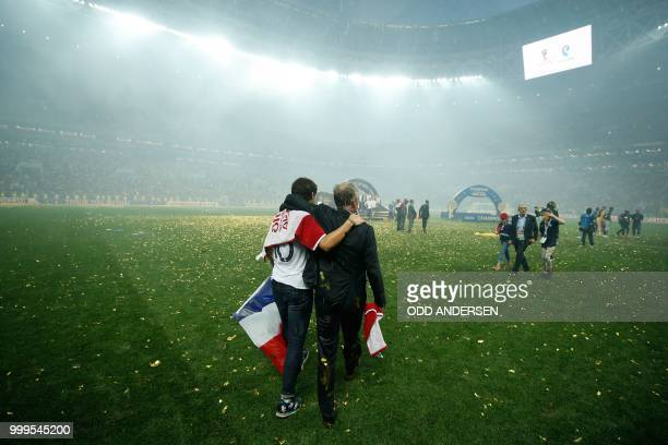 TOPSHOT France's coach Didier Deschamps celebrates with family after the Russia 2018 World Cup final football match between France and Croatia at the...