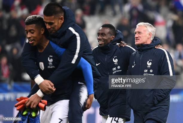TOPSHOT France's coach Didier Deschamps celebrates with players at the end of the friendly football match France vs Uruguay on November 20 2018 at...