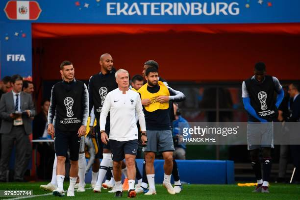 France's coach Didier Deschamps comes out for a training session with France's defender Lucas Hernandez France's midfielder Steven N'Zonzi France's...