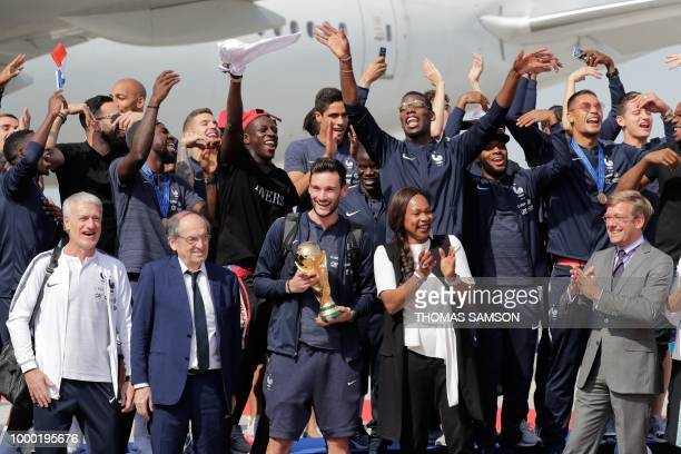 France's coach Didier Deschamps French Football Federation president Noel Le Graet France's goalkeeper Hugo Lloris with the trophy French Sports...