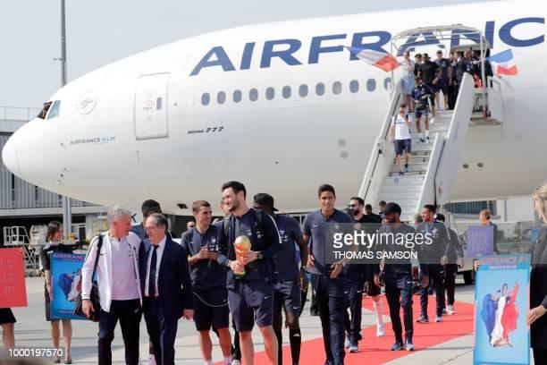France's coach Didier Deschamps French Football Federation president Noel Le Graet France's forward Antoine Griezmann and France's goalkeeper Hugo...