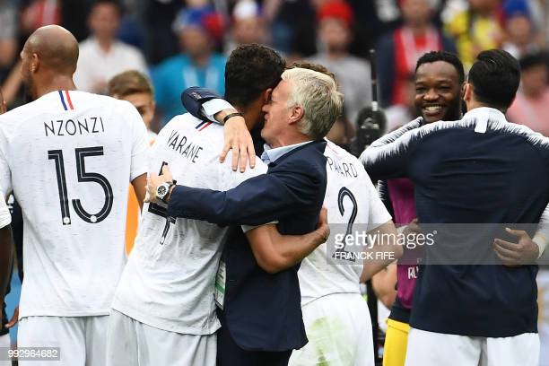 TOPSHOT France's coach Didier Deschamps hugs France's defender Raphael Varane as they celebrate at the end of the Russia 2018 World Cup quarterfinal...