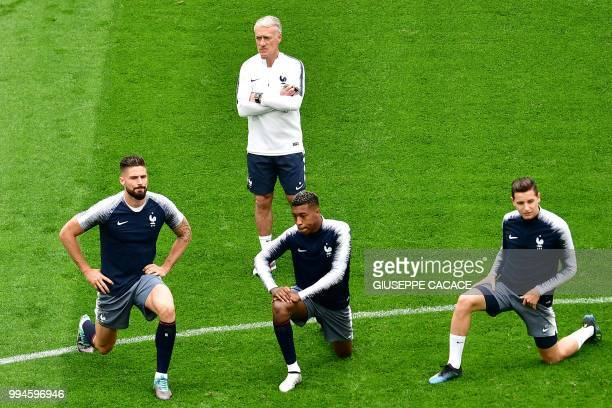 France's coach Didier Deschamps looks at France's forward Olivier Giroud France's defender Presnel Kimpembe and France's forward Florian Thauvin...