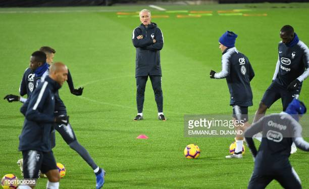 France's coach Didier Deschamps looks at French player taking part in a training session ahead of the UEFA Nations League football match between...