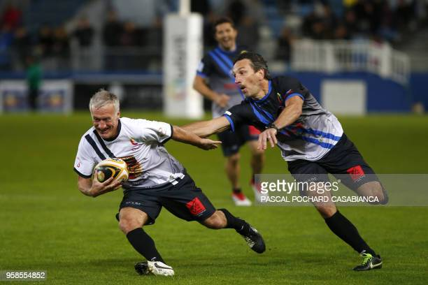 France's coach Didier Deschamps plays rugby during the charity match organized by French football player Pascal Olmeta for his association 'Un...