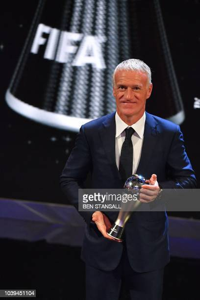 France's coach Didier Deschamps poses for a photograph after winning the trophy for the Best FIFA Men's Coach of 2018 Award during The Best FIFA...