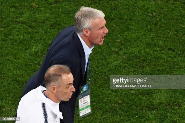 France's coach Didier Deschamps reacts during the Russia 2018 World Cup semifinal football match between France and Belgium at the Saint Petersburg...