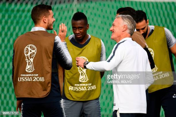 France's coach Didier Deschamps speaks to France's defender Lucas Hernandez next to France's midfielder Blaise Matuidi during a training session at...
