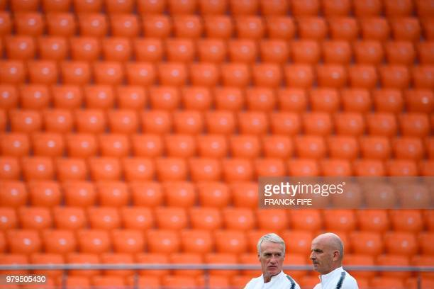 TOPSHOT France's coach Didier Deschamps stands with assistant coach Guy Stephan during a training session at the Ekaterinburg Arena in Ekaterinburg...