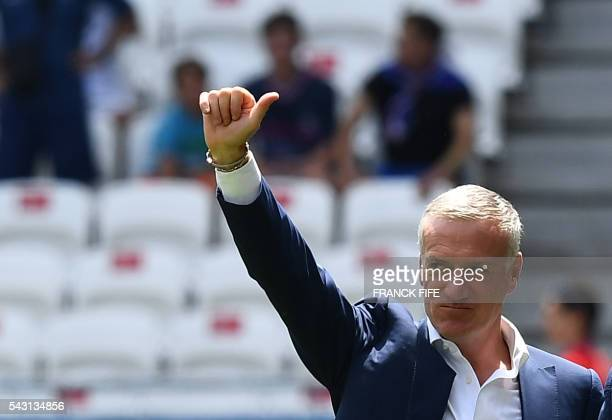 France's coach Didier Deschamps waves prior to the Euro 2016 round of 16 football match between France and Republic of Ireland at the Parc Olympique...
